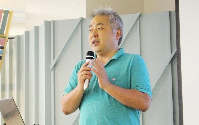 写真1:富永氏
